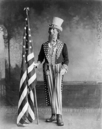 Free Photo: Uncle Sam Standing Beside the American Flag, 1898